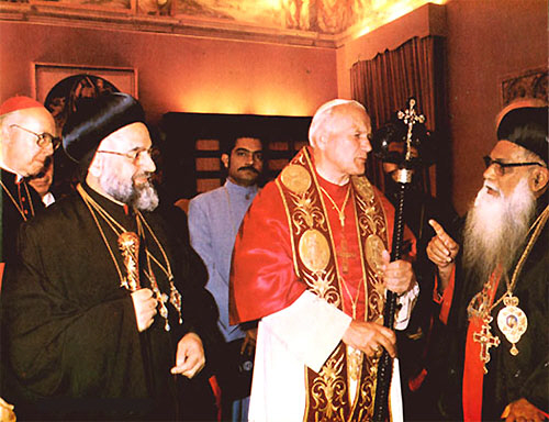 H.B. Caolicos Mor Baselios Paulose II of blessed memory presenting a Bishop's staff to Pope Paul VI